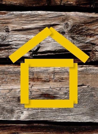 Symbole de maison sur fond de bois